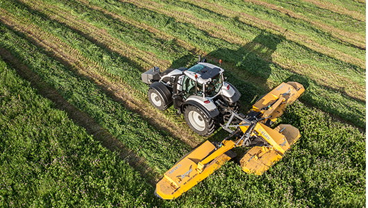 valtra tractor and twintrac on green field